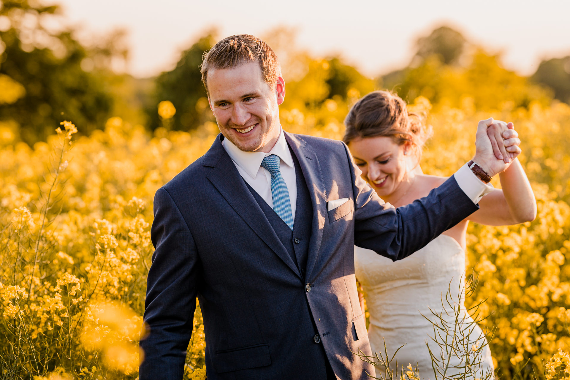 couple walking through fields at The Great Barn Aynho