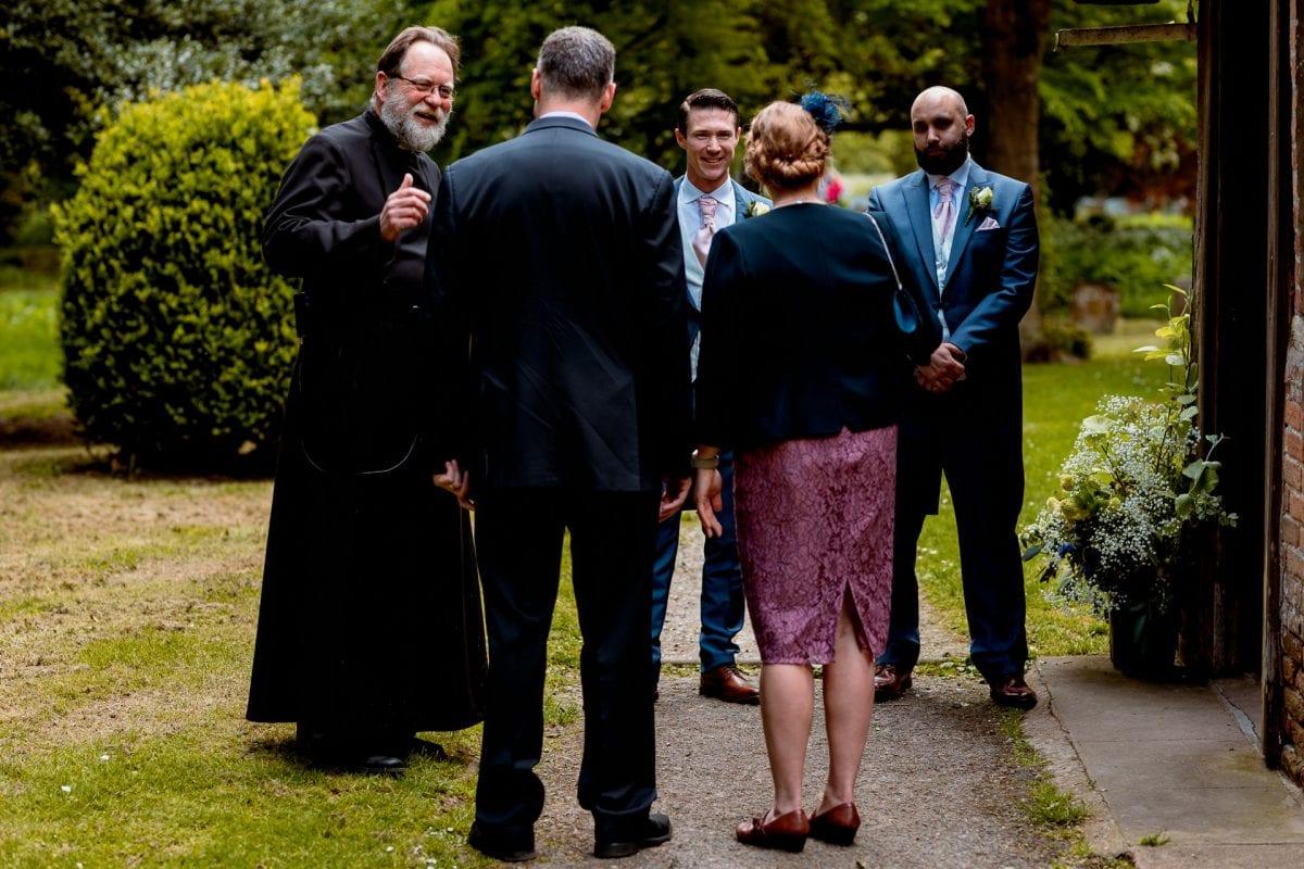 Vicar greeting the guests