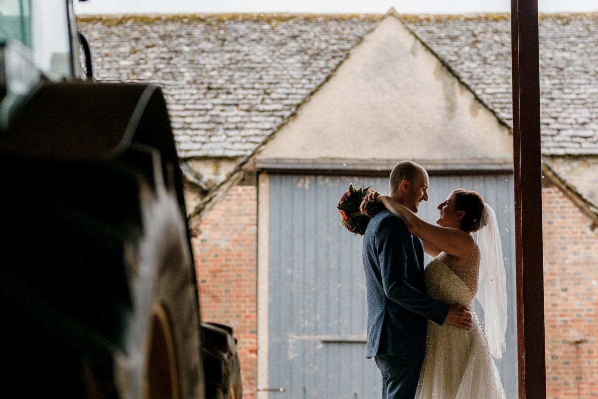 Beautiful wedding pictures in the rain on a farm. What to do if it rains on my wedding day?