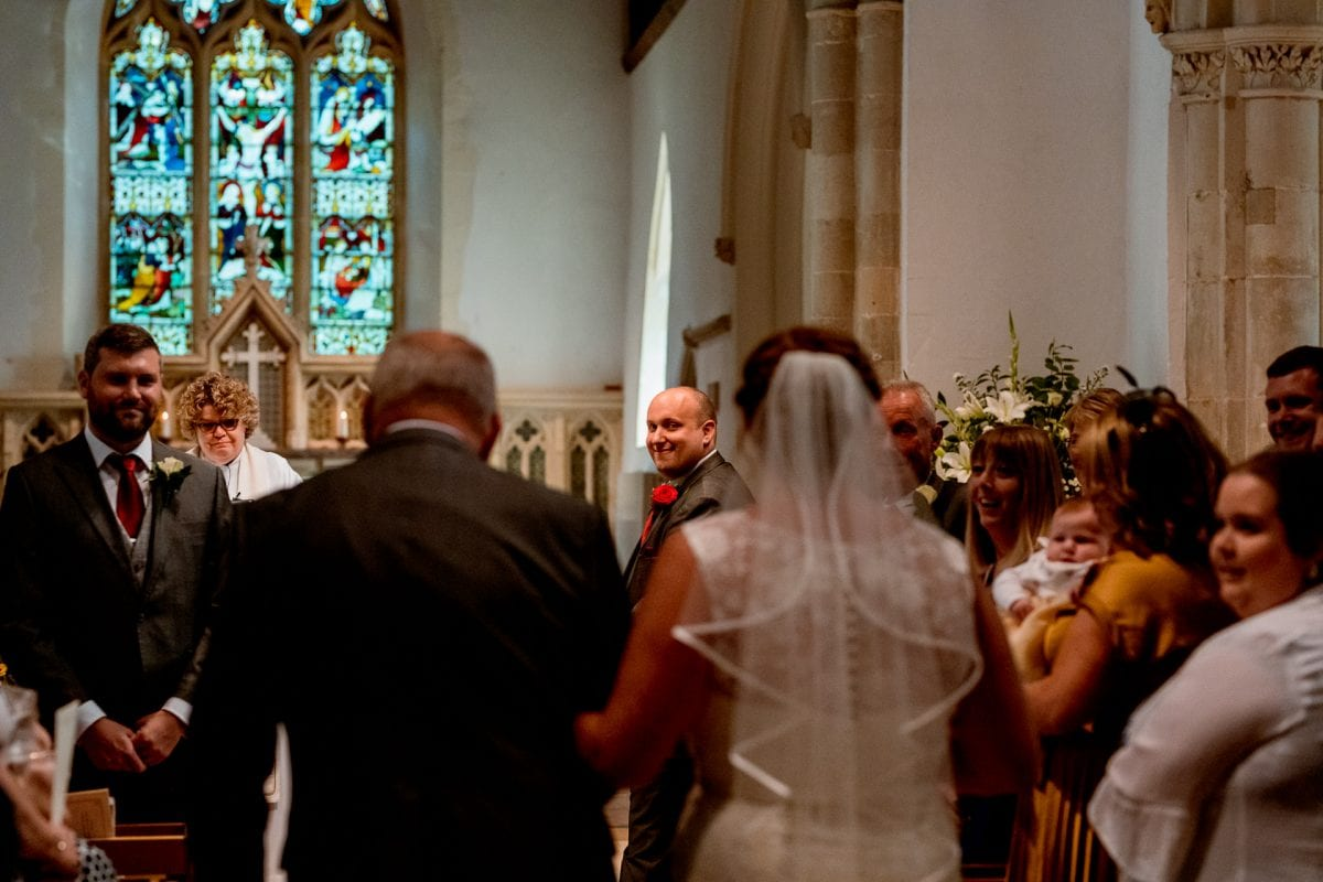 groom seeing his bride for the first time Wedding Photographer St Mary's Church Wendover Aylesbury Buckinghamshire