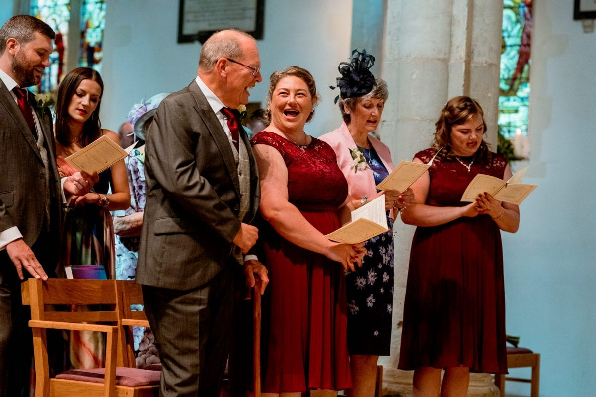 singing hymns Wedding Photographer St Mary's Church Wendover Aylesbury Buckinghamshire