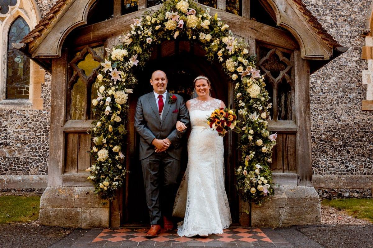 bride and groom leaving the church Wedding Photographer St Mary's Church Wendover Aylesbury Buckinghamshire