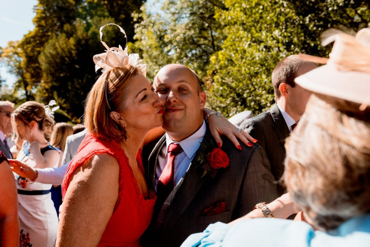 Wedding Photographer St Mary's Church Wendover Aylesbury Buckinghamshire kiss for the groom
