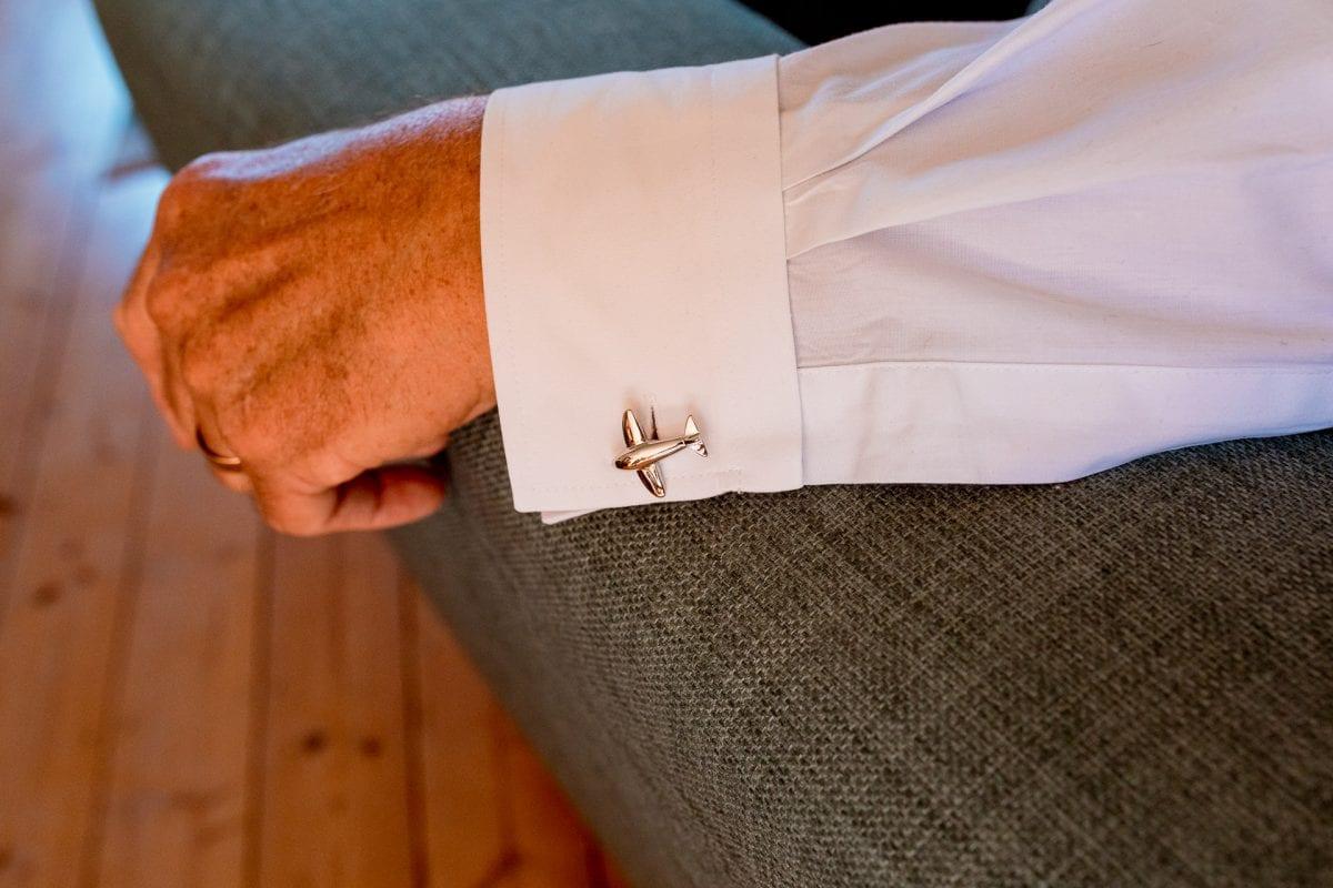 Wedding Photographer Buckinghamshire bride getting ready at home aeroplane cuff links