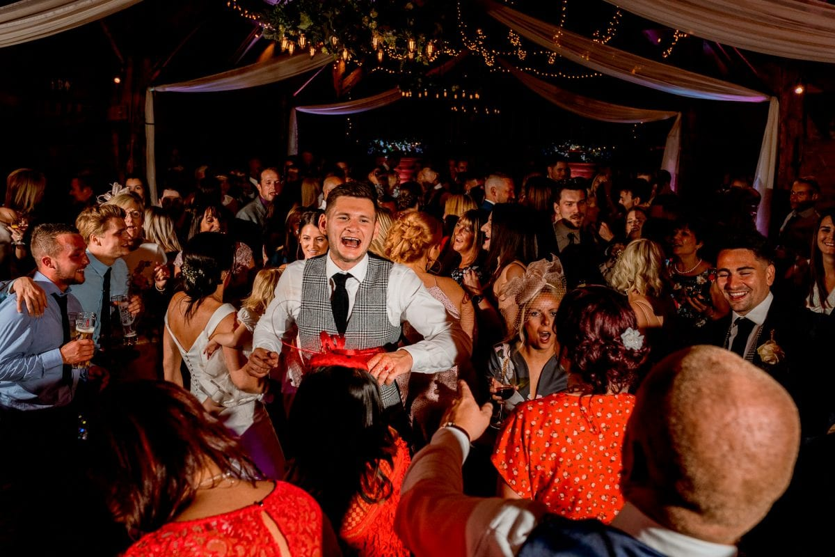 lains barn wedding photography blog oxfordshire groom dancing with guests