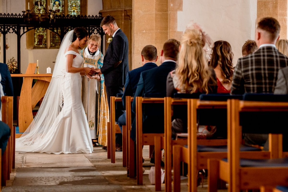 St Mary's Church Kidlington bride putting ring on grooms finger