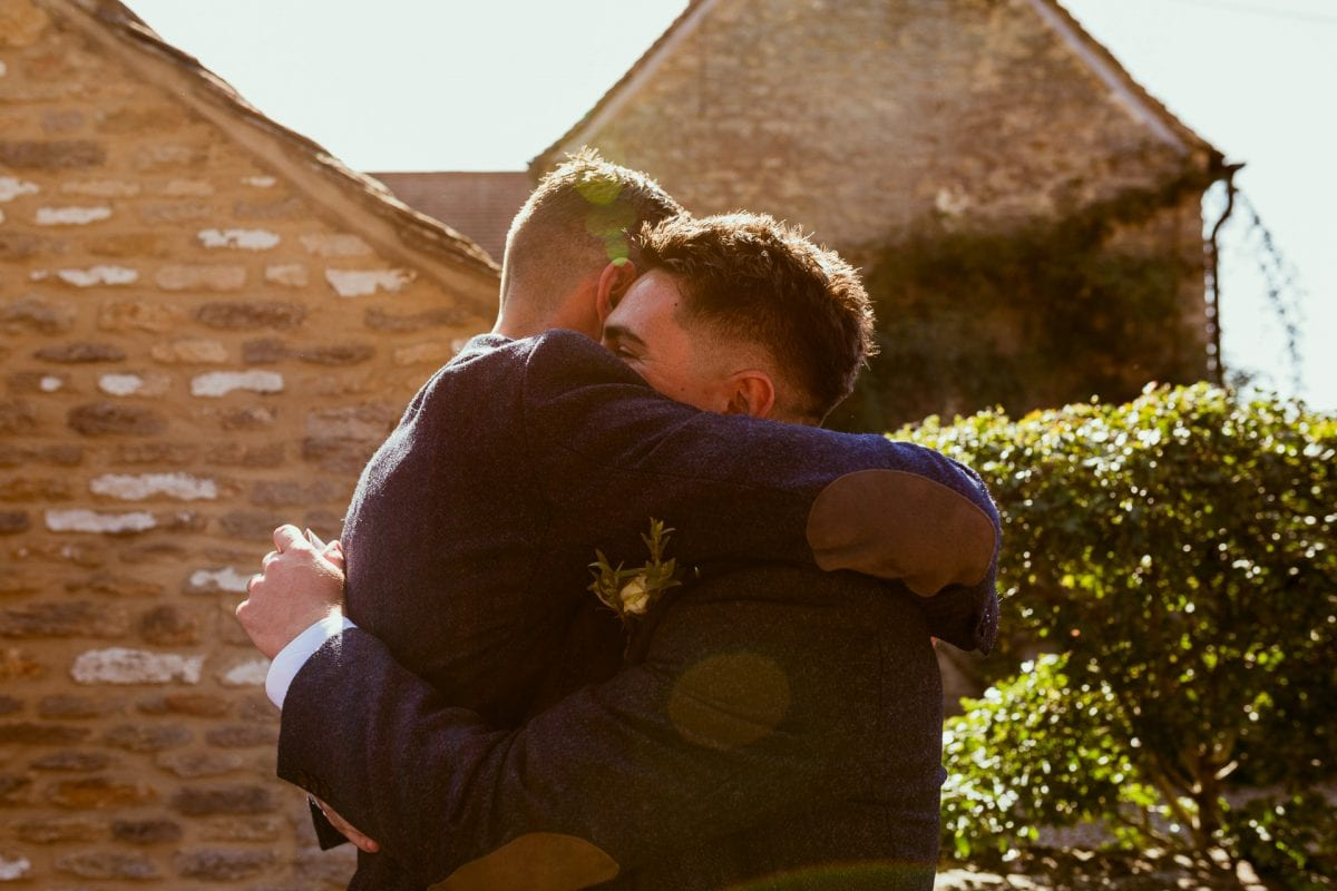 St Mary's Church Kidlington groom and best man having a hug