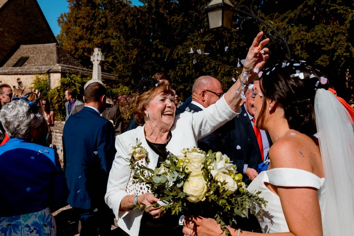 St Mary's Church Kidlington elderly relative throwing confetti over the bride