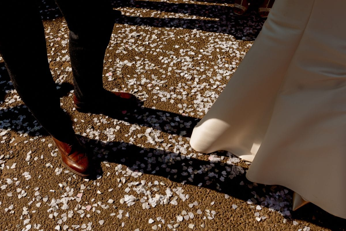St Mary's Church Kidlington confetti on the floor around the bride and grooms feet