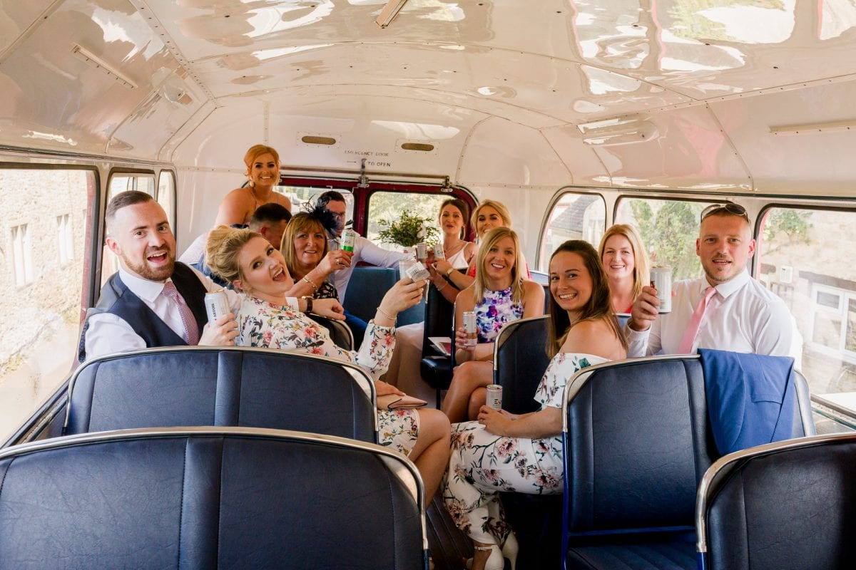 St Mary's Church Kidlington wedding guests on the vintage bus