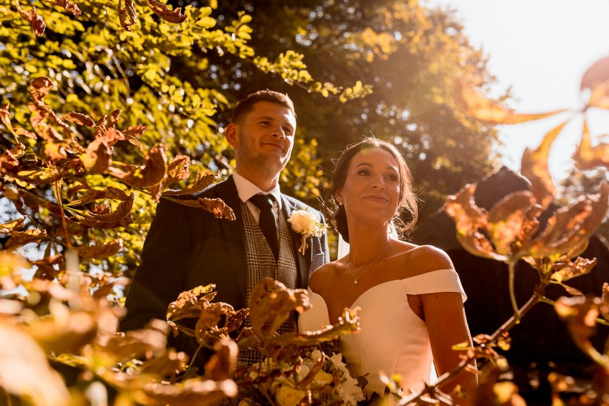 Wedding Couple stood in the grounds of Lains Barn in Oxfordshire on a beautiful sunny evening
