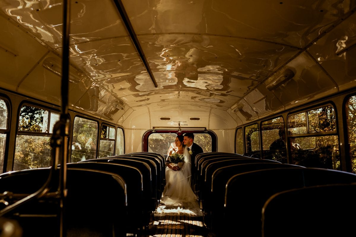 lains barn wedding photography blog oxfordshire on the back seat of a vintage bus