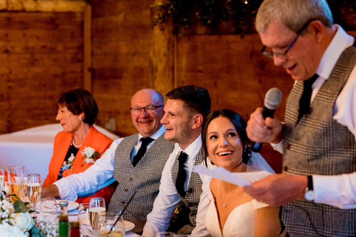 lains barn wedding photography blog oxfordshire laughing groom
