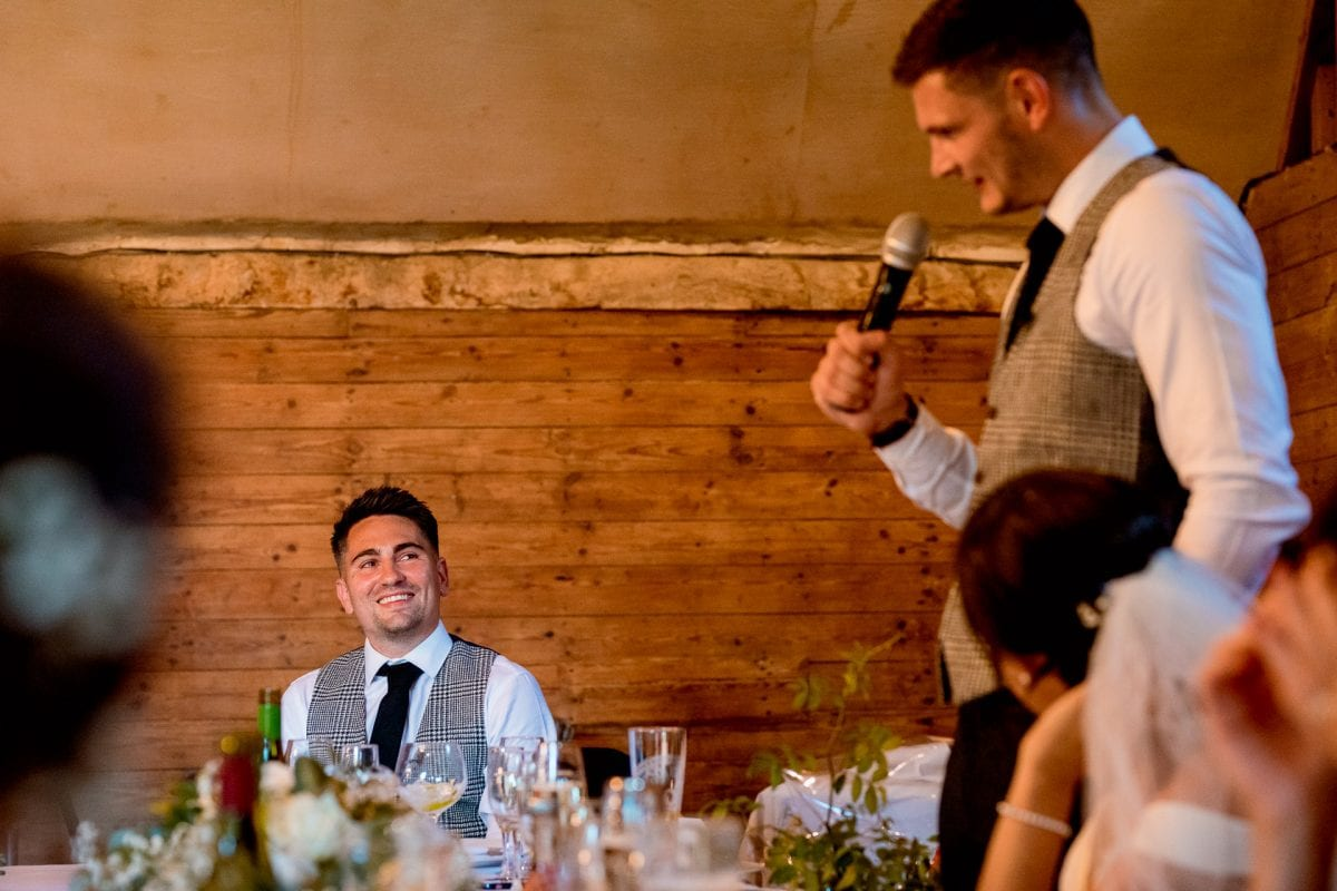 lains barn wedding photography blog oxfordshire groom talking to best man