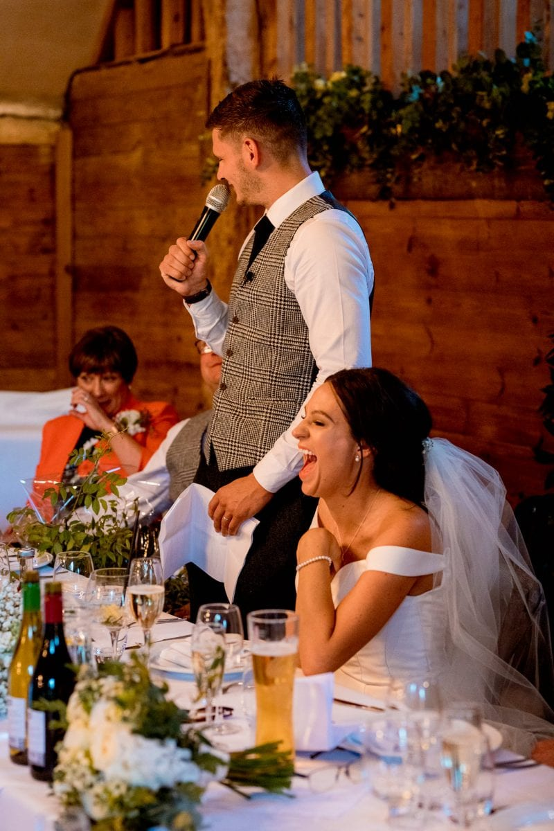 lains barn wedding photography blog oxfordshire bride laughing