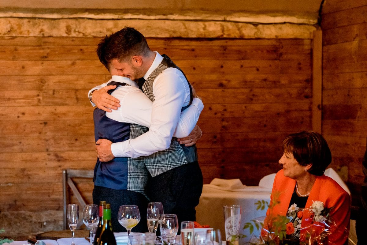 lains barn wedding photography blog oxfordshire best man and groom hug