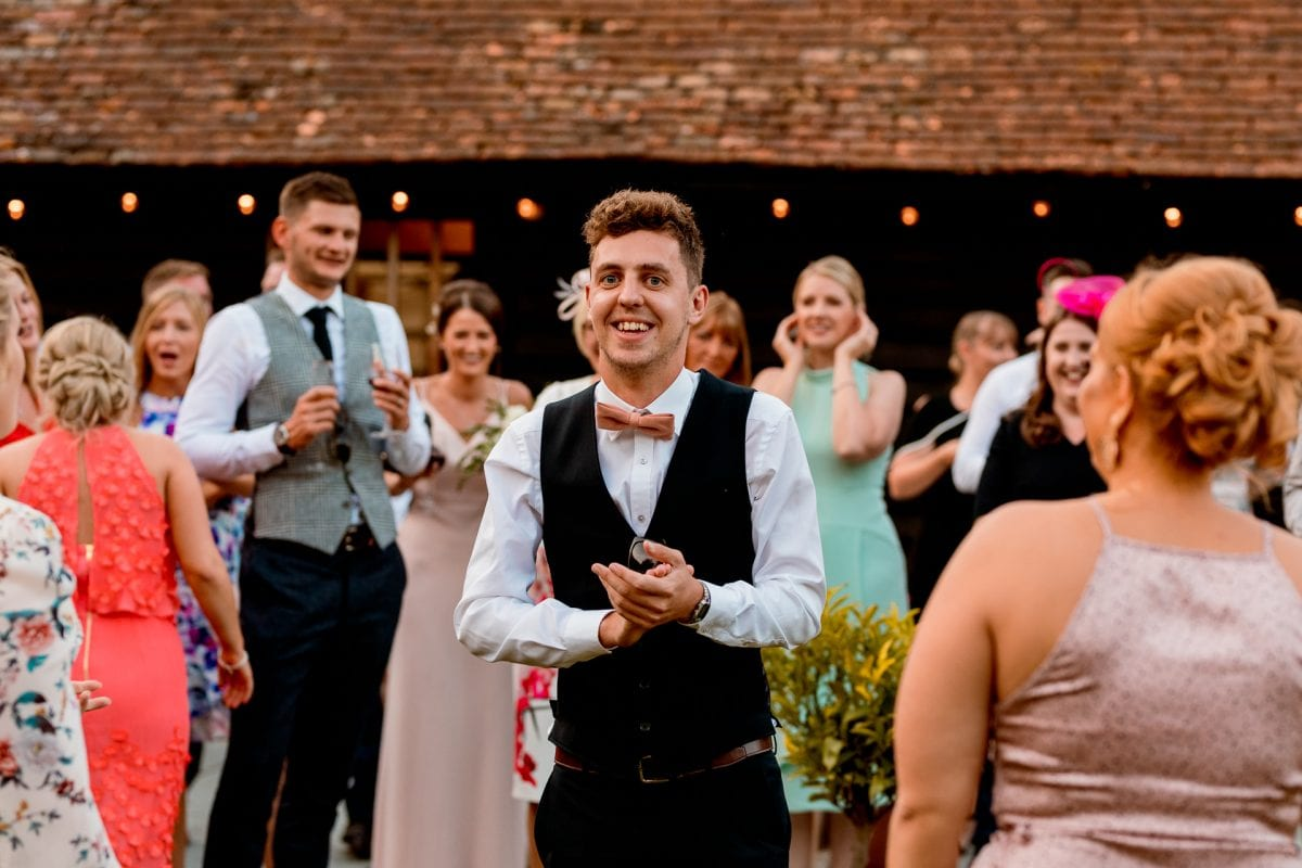 lains barn wedding photography blog oxfordshire boyfriend of girlfriend who caught the bouquet looking nervous
