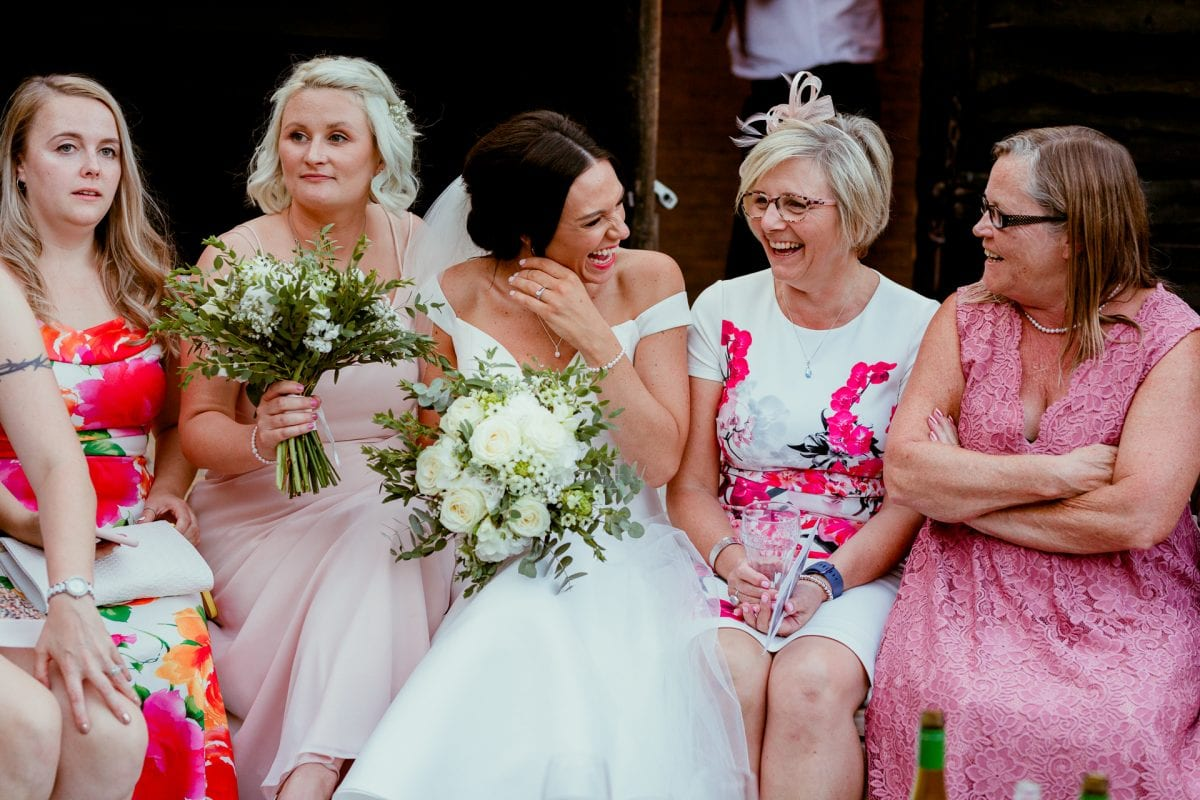 lains barn wedding photography blog oxfordshire bride sat with female guests