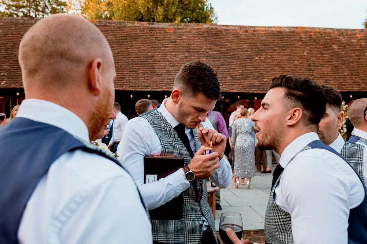 lains barn wedding photography blog oxfordshire groom lighting a cigar