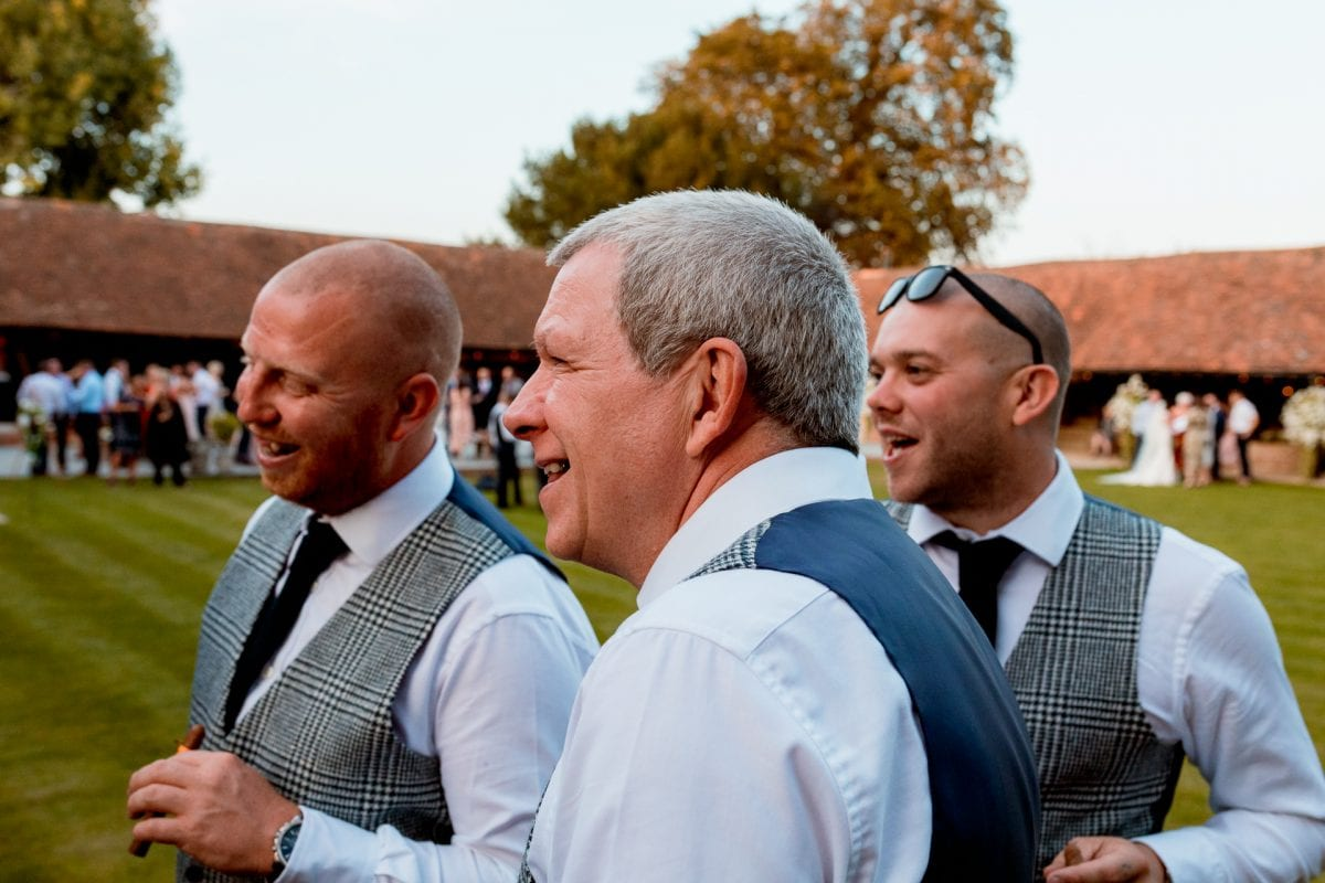 lains barn wedding photography blog oxfordshire guests having cigars
