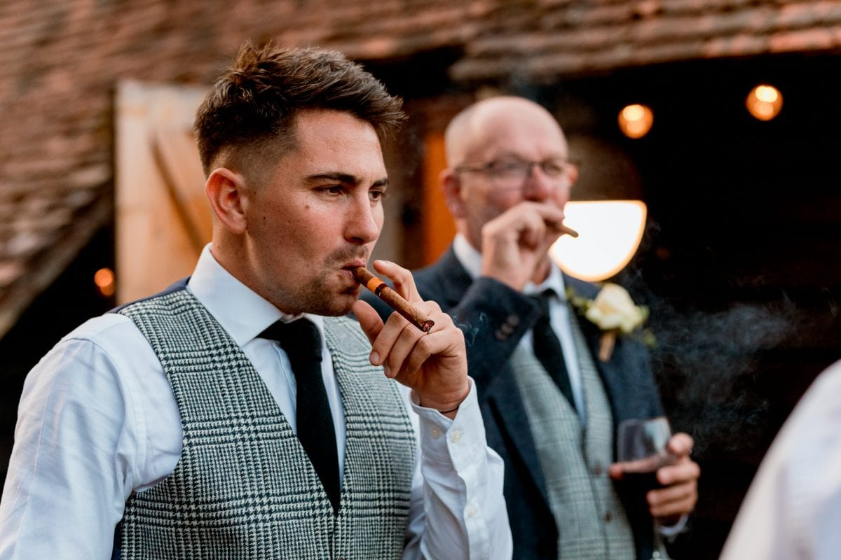 lains barn wedding photography blog oxfordshire best man having cigar