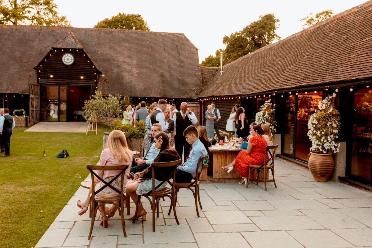 lains barn wedding photography blog oxfordshire guests relaxing after dinner