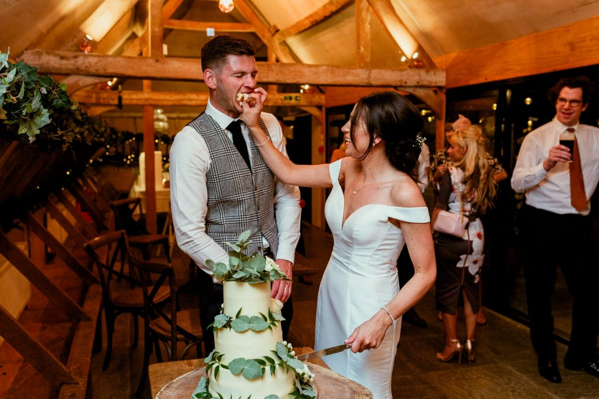 lains barn wedding photography blog oxfordshire bride feeding groom cake