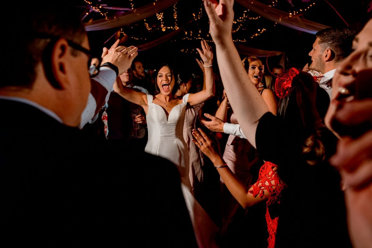 lains barn wedding photography blog oxfordshire bride dancing with guests