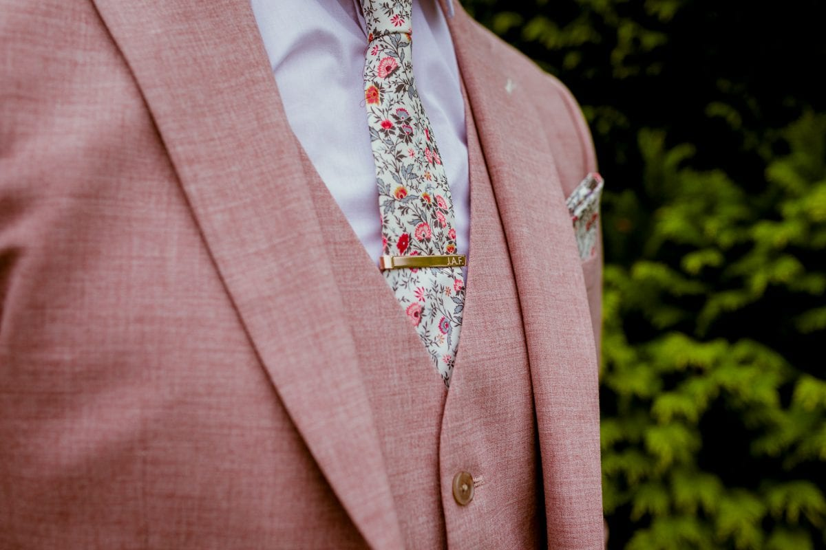 pink suit with flower tie for the groom