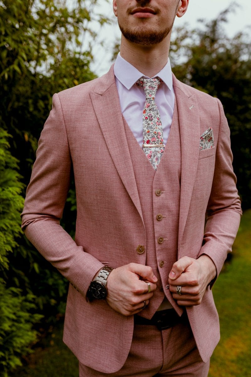 Pink wedding suit for the groom