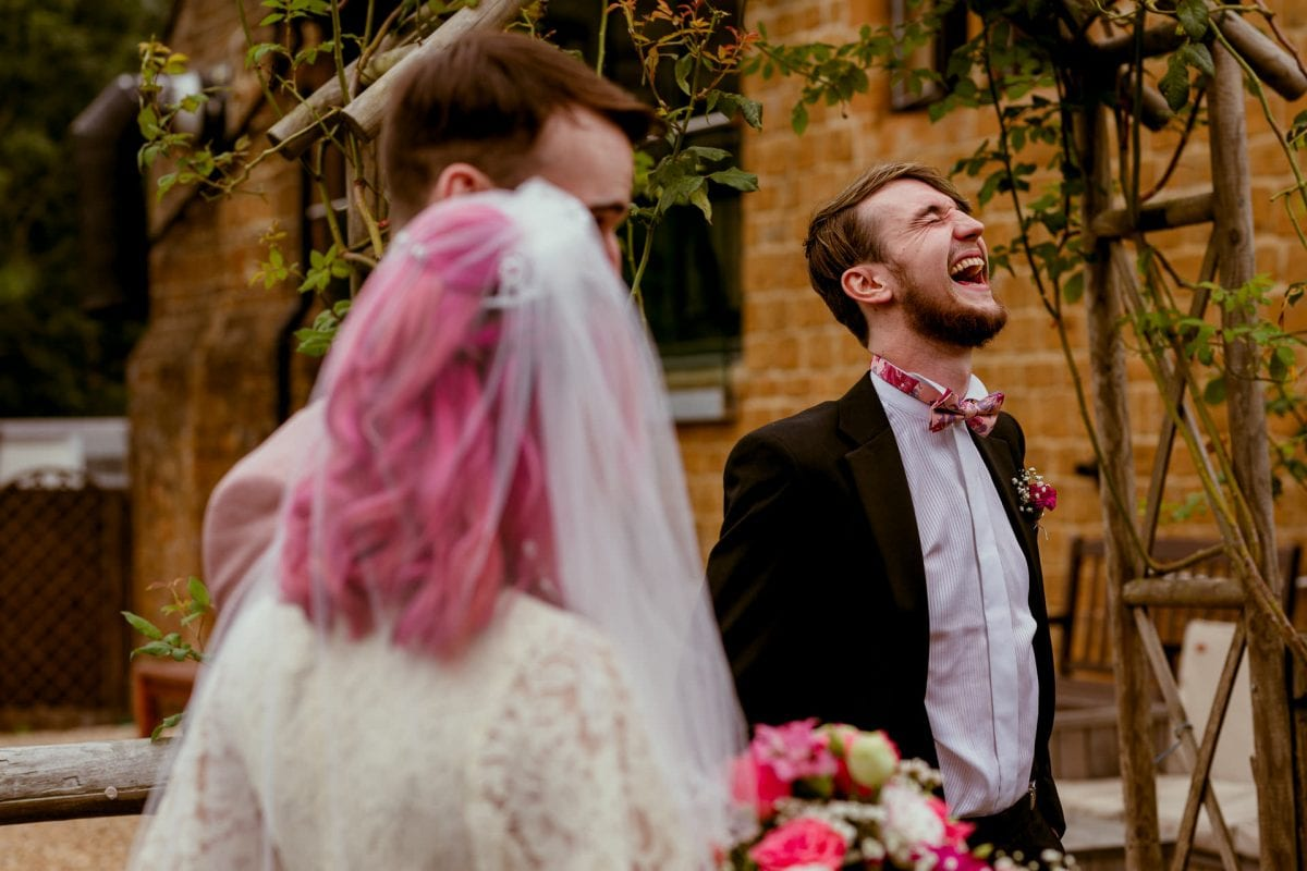 Best man and Celebrant laughing