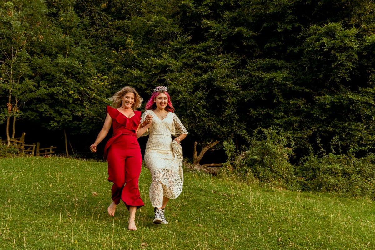 Best friends running down a hill