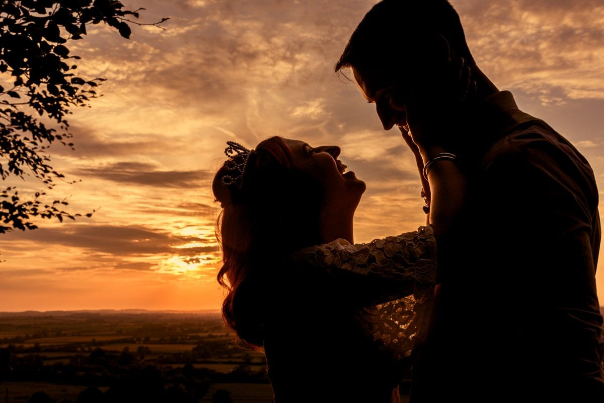 wedding couple at sunset near the edgehill castle