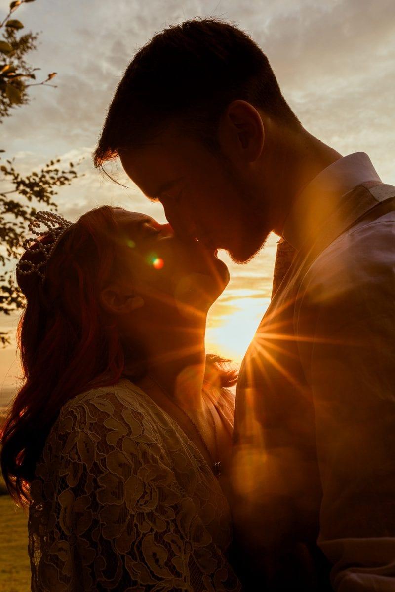 Couple kissing at sunset, edgehill castle