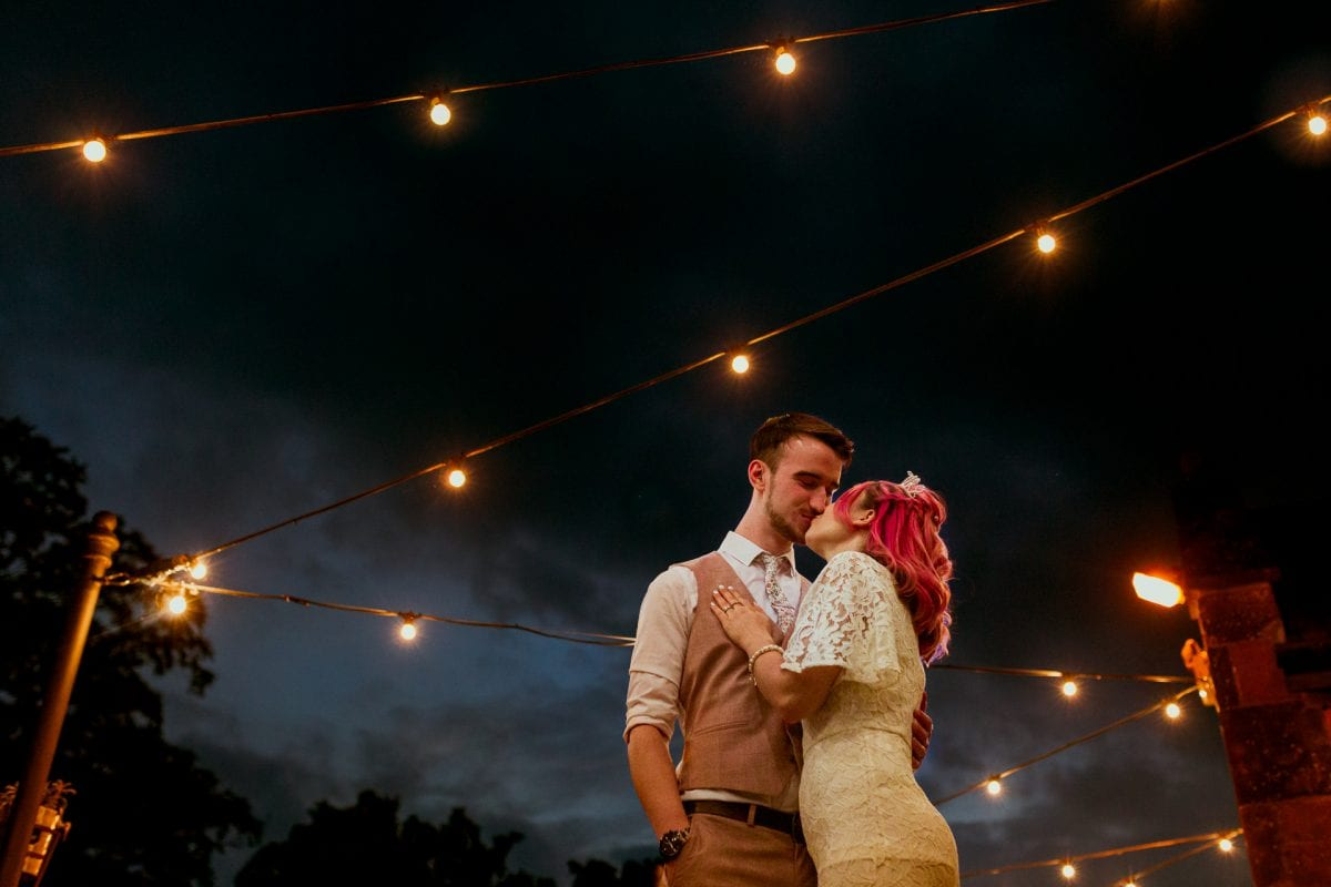 Night time scene bride and groom at The Castle Edgehill